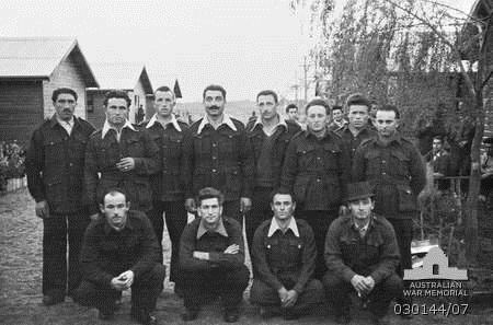 Italian prisoners in the prison camp at Hay, NSW - 9 Sep 1943. Cosmo Fardone (2nd row, 5th from left) Joseph Masciantonio (front row, 2nd from left)